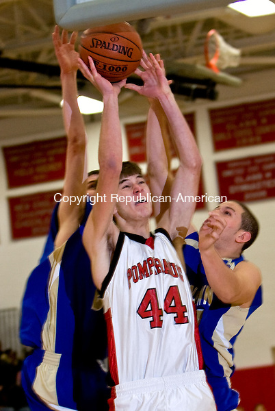 SOUTHBURY, CT - 02 JANUARY 2009 -010209JT05-<br /> Pomperaug's Andre Makris tries to make a shot under pressure from Newtown's Ian Cooper, left, and Nic Nazer, right, during Friday's game at Pomperaug. Pomperaug won, 57-34.<br /> Josalee Thrift / Republican-American