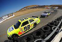 Jun. 21, 2009; Sonoma, CA, USA; NASCAR Sprint Cup Series driver Paul Menard (98) leads Jimmie Johnson during the SaveMart 350 at Infineon Raceway. Mandatory Credit: Mark J. Rebilas-