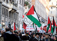 Manifestazione nazionale a Roma, 17 gennaio 2009, di solidarieta' col popolo palestinese e contro i raid israeliani nella striscia di Gaza..A Palestinian flag joined with a flag depicting an Israeli David's Star flanked by a swastika is waved during a national demonstration in Rome, 17 january 2009, in solidarity with Palestinians and against Israel's continued incursion into Gaza strip..UPDATE IMAGES PRESS/Riccardo De Luca