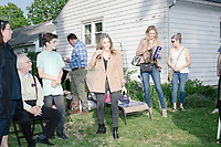Democratic presidential candidate and spiritual guru Marianne Williamson greets people as she arrives to speak to a small crowd in the back yard of Kathleen O'Donnell at a campaign house party event in Keene, New Hampshire, on Wed., May 22, 2019.