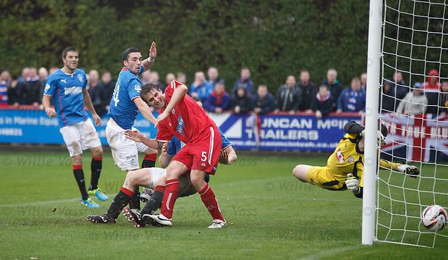 Nicky Law's free-kick sails over the heads of everyone and straight into the net for goal no 3 to Rangers