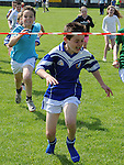 Tom Gray wins the under 10 race at Naomh Mairtin sports day. Photo: Colin Bell/pressphotos.ie