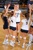 13 November 2010:  FIU's team (pictured are Una Trkulja (7), Angelina Colon (4), Chanel Araujo (13), Natalia Valentin (9)) celebrate winning a point in the first set as the FIU Golden Panthers defeated the South Alabama Jaguars, 3-0 (25-12, 25-12, 25-20), at U.S Century Bank Arena in Miami, Florida.