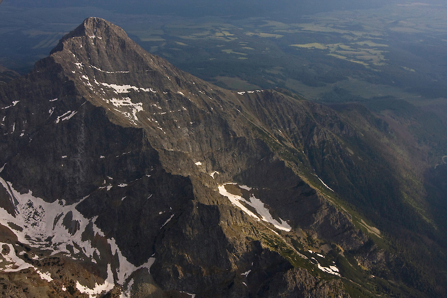 Aerial view of the inaccessible northern slope of Mount Krivàn (2495m als), national symbol of Slovakia. On the background the valley of Liptov and the Low Tatras mountain range. Western Tatras, Slovakia. June 2009. Mission: Ticha