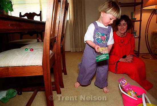 Noah Nelson and Phyllis Nelson look for eggs on Easter.<br />