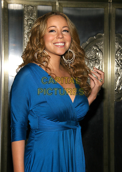 MARIAH CAREY.Bette Midler's annual HULAWEEN Hawaiian Halloween.extravaganza benefit and tenth anniversary celebration for the New York Restoration Project, New York, New York..October 31st, 2005.Photo: Jackson Lee/Admedia/Capital Pictures.Ref: JL/ADM.half length hoop earrings blue dress wrap around hand in hair.www.capitalpictures.com.sales@capitalpictures.com.© Capital Pictures.