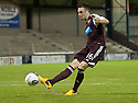 Hearts' Brad McKay scores the winning penalty.