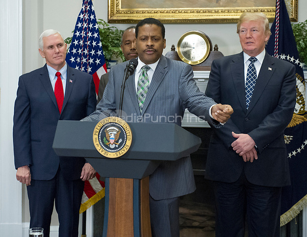 Isaac Newton Farris, Jr., Nephew of Martin Luther King Jr., makes remarks prior to US President Donald J. Trump signing a proclamation to honor Dr. Martin Luther King, Jr. Day in the Roosevelt Room of the White House in Washington, DC on Friday, January 12, 2018.  From left to right: US Vice President Mike Pence, US Secretary of Housing and Urban Development Ben Carson, Mr. Farris, and President Trump.<br /> Credit: Ron Sachs / CNP /MediaPunch