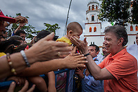BOGOTA, Colombia. 1st June 2014. The President of Colombia and candidate, Juan Manuel Santos greets his supporters during a walk in Floridablanca, during his tour of the country for re-election in runoff. Photo by SANTOS Campaign/Juan José Horta / VIEWpress TO EDITORS : THIS PICTURE WAS PROVIDED BY A THIRD PARTY.  THIS PICTURE IS DISTRIBUTED EXACTLY AS RECEIVED BY VIEWpress, AS A SERVICE TO CLIENTS