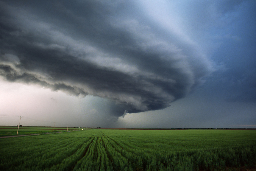 "A High Precipitation ""HP"" supercell thunderstorm produces baseball size hail as it approaches a field of green wheat near Duke OK on April 18th, 1992."