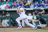 Florida Gators first baseman Peter Alonso (20) follows through on his swing against the Coastal Carolina Chanticleers in Game 4 of the NCAA College World Series on June 19, 2016 at TD Ameritrade Park in Omaha, Nebraska. Coastal Carolina defeated Florida 2-1. (Andrew Woolley/Four Seam Images)