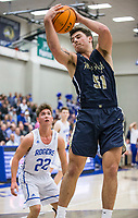 Jonas Higson, Bentonville West forward, wins a rebound vs Rogers Tuesday, Jan. 14, 2020, at King Arena in Rogers.<br /> Go to http://bit.ly/2FVKUXz to see more photos.<br /> (NWA Democrat-Gazette/Ben Goff)