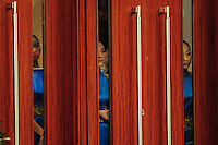 Aug. 9, 2008; Beijing, CHINA; Flower presenters peek through a door as they await the medal ceremony following the womens fencing individual sabre final at the Fencing Hall in the 2008 Beijing Olympic Games. Mandatory Credit: Mark J. Rebilas-