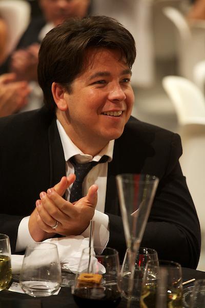 Michael McIntyre claps during speeches at Elton John's White Tie and Tiara Ball