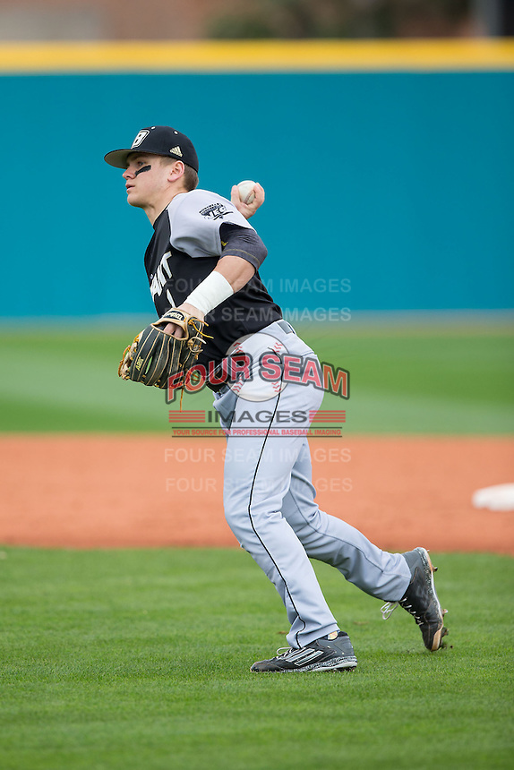 Cole Fabio (1) of the Bryant Bulldogs takes infield practice prior to the game against the Coastal Carolina Chanticleers at Springs Brooks Stadium on March 13, 2015 in Charlotte, North Carolina.  The Chanticleers defeated the Bulldogs 7-2.  (Brian Westerholt/Four Seam Images)
