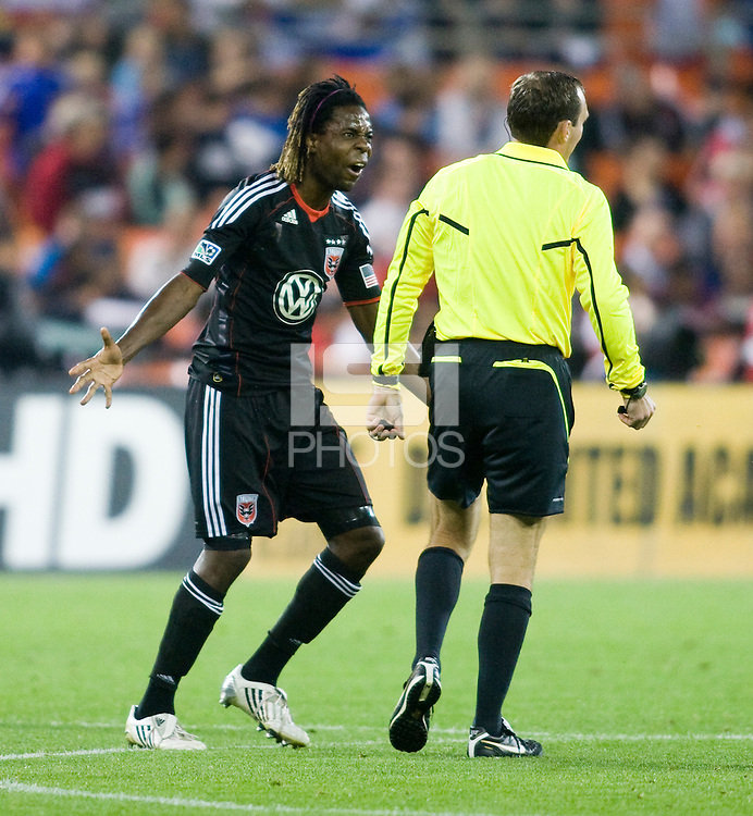 Joseph Ngwenya (11) argues a call with referee Terry Vaughn during the game at RFK Stadium in Washington, DC.  D.C. United tied the Colorado Rapids, 1-1.
