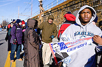 "People line up at the train station in Wilmington, Delaware on January 17th, 2009, part of Barack Obama's ""Whistle Stop Tour"" en route to Washington D.C. for his inauguration as President."