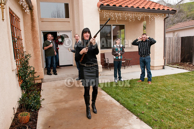 Lisa Lucke shoots a round of black powder  in her front yard during Jackson, California's Serbian community celebration of Christmas  on January 7.
