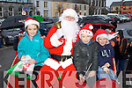 Pictured with Santa at the  parade in Listowel on Sunday were l-r: Cliodhna Pierce, Tiernan Pierce and Danny Keane..