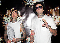LAS VEGAS, NV - December 31 : Travis Barker and Yelawolf peform at RAIN Nightclub at Palms Resort in Las Vegas, Nevada on December 31, 2012.  Credit: Kabik/Starlitepics/MediaPunch Inc.