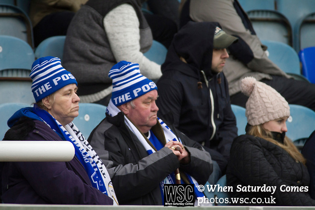 Peterborough United 1 Chesterfield 0, 21/03/2015. Abax Stadium, League One. Home supporters in the main stand watching the second half action at the Abax Stadium, as Peterborough United play Chesterfield in a SkyBet League One fixture. The home team won the match by one goal to nil, watched by a crowd of 6,612. The result allowed Peterborough to leapfrog their opponents into the League One play-off positions with eight games remaining of the season. Photo by Colin McPherson.