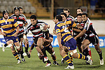 Niva Ta'auso breaks through the Bay midfield during the Air NZ Cup rugby game between Bay of Plenty & Counties Manukau played at Blue Chip Stadium, Mt Maunganui on 16th of September, 2006. Bay of Plenty won 38 - 11.
