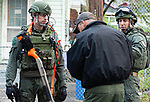 WATERBURY,  CT-051719JS05-  Waterbury police officers finish up a search of a home on Jewelry Street in Waterbury as part of and operation on Friday.  Waterbury police along with cooperations State Police, Watertown Police, the States Attorney's Office, the DEA and ATF conducted search and seizures as well as searching for wanted suspects who police say were suspected in the sale of heroin.<br /> Jim Shannon Republican American