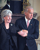 Washington, D.C. - May 1, 2009 -- United States Vice President Joseph Biden catches himself and Health and Human Services Secretary Kathleen Sebelius as he tripped off the steps following the ceremonial swearing-in in the East Room of the White House in Washington, D.C. on Friday, May 1, 2009. <br /> Credit: Ron Sachs / CNP