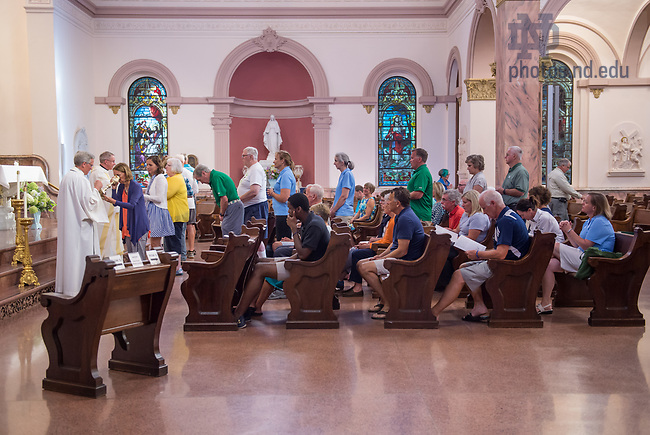 August 15, 2017; On Day 2 of the ND Trail, pilgrims celebrate mass at Saint Mary-of-the-Woods' Church of the Immaculate Conception in St. Mary's,  Indiana. As part of the University's 175th anniversary celebration, the Notre Dame Trail will commemorate Father Sorin and the Holy Cross Brothers' journey. A small group of pilgrims will make the entire 300+ mile journey from Vincennes to Notre Dame over  two weeks. (Photo by Barbara Johnston/University of Notre Dame)