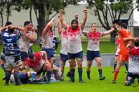 Ryan Shelford (centre) and his Horowhenua Kapiti teammates celebrate winning the Mitre 10 Heartland Championship rugby union match between Horowhenua Kapiti and Wanganui at Levin Domain in Levin, New Zealand on Saturday, 7 October 2017. Photo: Dave Lintott / lintottphoto.co.nz