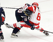 Rebecca Hewett (UConn - 18), Kayla Tutino (BU - 8) - The Boston University Terriers defeated the visiting University of Connecticut Huskies 4-2 on Saturday, November 19, 2011, at Walter Brown Arena in Boston, Massachusetts.