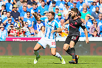 Laurent Depoitre of Huddersfield Town and Shkodran Mustafi of Arsenal during the Premier League match between Huddersfield Town and Arsenal at the John Smith's Stadium, Huddersfield, England on 13 May 2018. Photo by Thomas Gadd / PRiME Media Images.