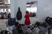 Pictured: Migrants in the passenger station Monday 08 Fabruary 2016<br /> Re: Migrants wait in the Piraeus passenger station to be transported to the migrants' camp in Elliniko, Athens, Greece