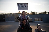People wait outside a hangar to catch a glimpse of Ron Paul after a rally at Jet Aviation in Nashua, New Hampshire, on Jan. 6, 2012.  Paul is seeking the 2012 GOP Republican presidential nomination.