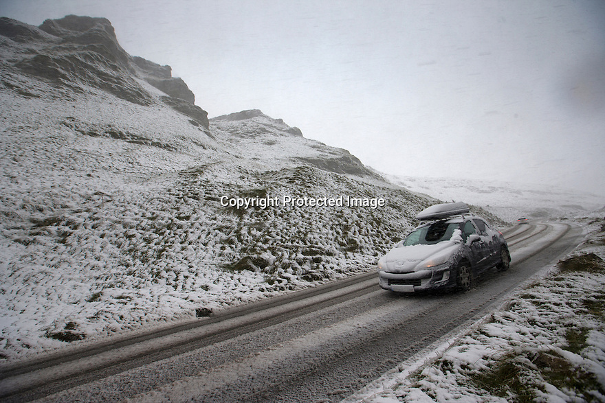 18/11/16<br /> <br /> A car makes its way down Winnats Pass after heavy snowfall turns the Peak District near Castleton into a winter wonderland.<br /> <br /> All Rights Reserved F Stop Press Ltd. (0)1773 550665   www.fstoppress.com