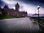 Boardwalk of Dufferin terrace and the Fairmont Le Château Frontenac castle at dusk with dramatic night sky and street lights, luxury grand hotel Chateau Frontenac, National Historic Site of Canada. Old Quebec City, Quebec, Canada. Terrasse Dufferin, Ville de Québec.