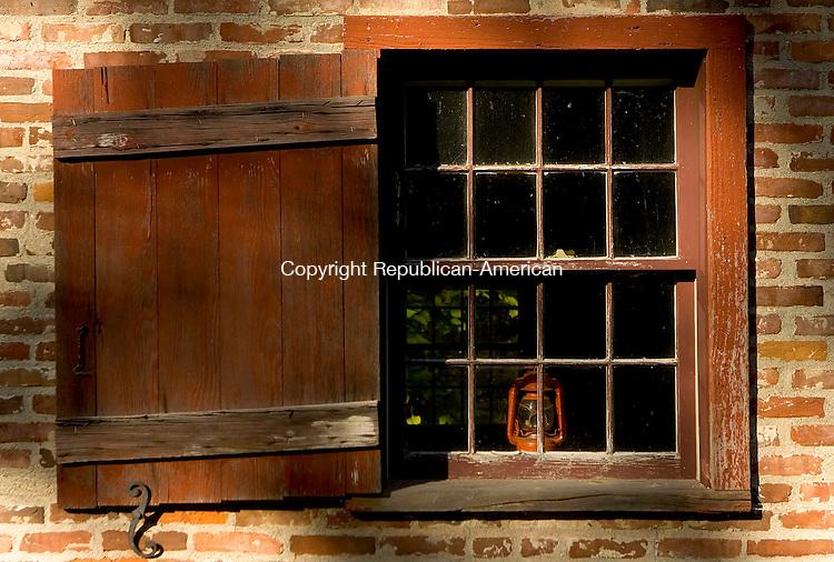 WARREN, CT- 07 OCTOBER 2008 --100708JS13--A lantern in the window of Warren's 1784 Brick School house.<br /> Jim Shannon / Republican-American