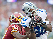 Dallas Cowboys wide receiver Dez Bryant (88) catches a touchdown pass against the Washington Redskins cornerback David Amerson (39) in the first quarter at FedEx Field in Landover, Maryland on Sunday, December 28, 2014.  <br /> Credit: Ron Sachs / CNP