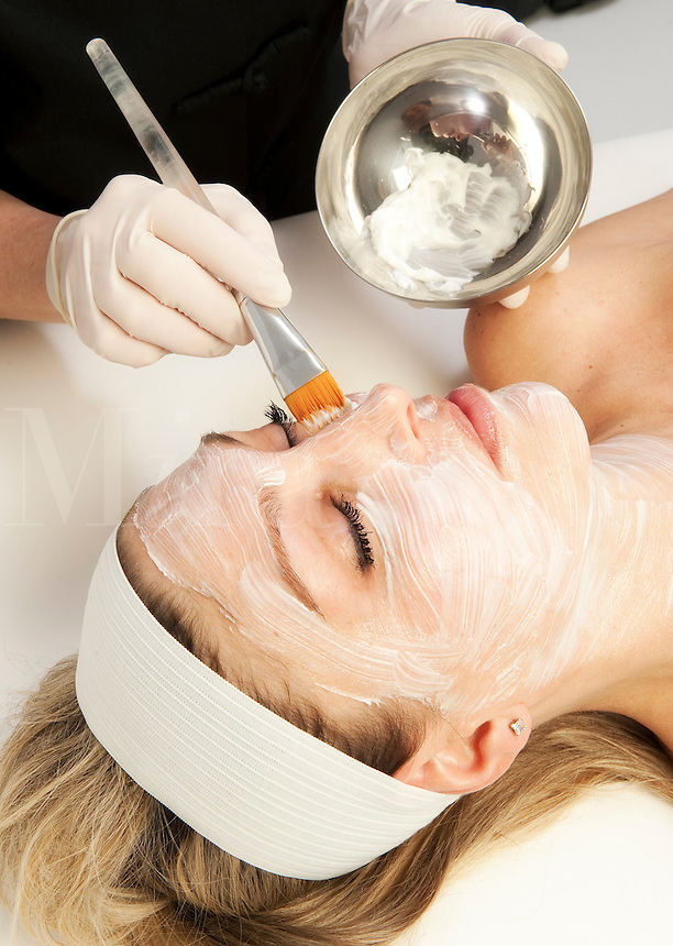 Woman getting a facial tratment at a spa.