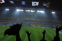 Fan raise their hands in the air after South Africa scores a goal in the South Africa v. Spain Group B first round match of the 2002 World Cup at the World Cup stadium in Daejeon, South Korea on June 12th, 2002.  Spain won the match 3-2.