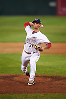 Auburn Doubledays relief pitcher Robbie Dickey (31) delivers a pitch during a game against the Williamsport Crosscutters on June 25, 2016 at Falcon Park in Auburn, New York.  Auburn defeated Williamsport 5-4.  (Mike Janes/Four Seam Images)