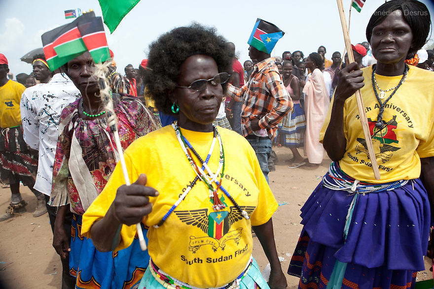 Saturday 9 july 2011 - Juba, Republic of South Sudan - South Sudanese traditional dancers  wave the flag of their new country and dance during South Sudan's independence day celebrations in Juba. Tens of thousands of citizens of the new South Sudan celebrate national independence but whether statehood will resolve issues of identity after a decades-long war remains to be seen. Photo credit: Benedicte Desrus