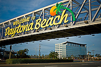 Pedestrian footbridge over U. S. 92 / International Speedway Blvd. in front of the Daytona International Speedway. In the background is the building that houses the headquarters of NASCAR, International Speedway Corp. and Grand-Am at 1 Daytona Blvd.