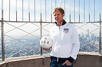 ESPN analyst and former men's national team defender Alexi Lalas poses for a photo on the observation deck of the Empire State Building during the centennial celebration of U. S. Soccer in New York, NY, on April 05, 2013.