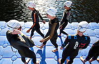 30 JUN 2011 - LONDON, GBR - Jodie Stimpson (centre) walks along the pontoon before the start of her super sprint elimination heat at the GE Canary Wharf Triathlon (PHOTO (C) NIGEL FARROW)