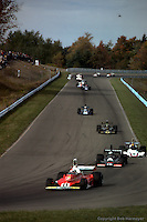 WATKINS GLEN, NY - OCTOBER 5: Clay Regazzoni #11 Ferrari 312T 024/Ferrari 015 leads Tom Pryce #16 Shadow DN5 2A/Ford Cosworth DFV, Carlos Pace #8 Brabham BT44B 3/Ford Cosworth and others during the United States Grand Prix on October 5, 1975, at the Watkins Glen Grand Prix Race Course near Watkins Glen, New York.