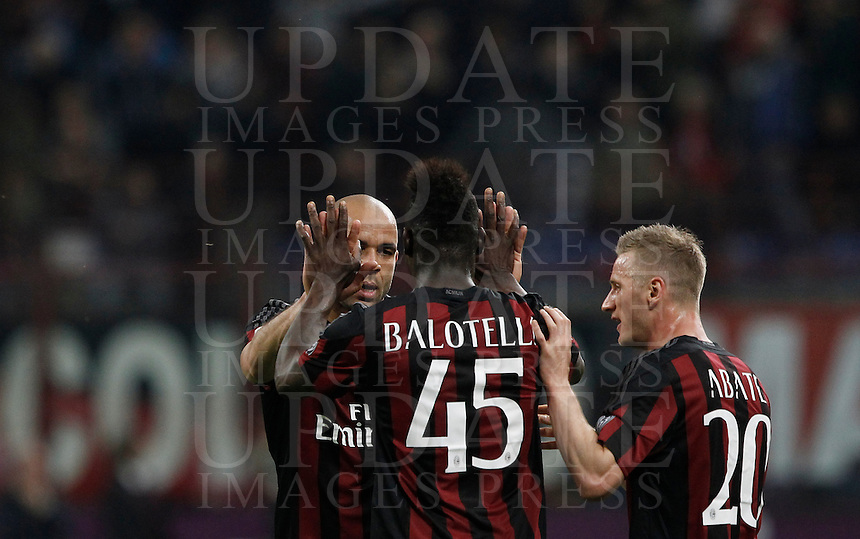 Calcio, Serie A: Milan vs Juventus. Milano, stadio San Siro, 9 aprile 2016. <br /> AC Milan&rsquo;s Alex, left, celebrates with teammates Mario Balotelli, center, and Ignazio Abate, after scoring during the Italian Serie A football match between AC Milan and Juventus at Milan's San Siro stadium, 9 April 2016.<br /> UPDATE IMAGES PRESS/Isabella Bonotto