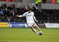 Pictured: Jordi Gomez of Swansea scoring the third goal for his team from a free kick<br />
