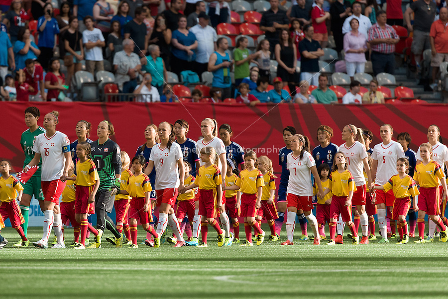 June 8, 2015:  The teams enter the stadium for a Group C match at the FIFA Women's World Cup Canada 2015 between Japan and Switzerland at BC Place Stadium on 8 June 2015 in Vancouver, Canada. Sydney Low/AsteriskImages