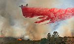 Retardant drop from 83 (Columbia Airatack) at theFlat Fire started on Highway 49 near Moccasin and burned up hill toward Priest Dam. Photo by Al Golub